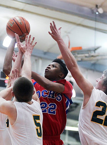 Sarah Nader- snader@shawmedia.com Dundee-Crown's Juwan Stewart (center) shoots a basket during the third quarter of Monday's Crystal Lake Central Regional against Crystal Lake South on March 3, 2014. Dundee-Crown defeated Crystal Lake South, 61-52.