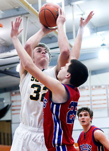 Sarah Nader- snader@shawmedia.com Crystal Lake South's Wes Bucker (left) shoots over Dundee-Crown's Conner Steinmetz during the third quarter of Monday's Crystal Lake Central Regional March 3, 2014. Dundee-Crown defeated Crystal Lake South, 61-52.