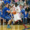 Mooseheart's Mangisto Deng (24) drives baseline against Newark's Evan Schomer at Somonauk High School in Somonauk, IL on Friday, February 28, 2014 (Sean King for Shaw Media)