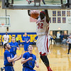 Mooseheart's Makur Puou (32) slam dunks over Newark's Evan Schomer (24) during the third quarter of play at Somonauk High School in Somonauk, IL on Friday, February 28, 2014 (Sean King for Shaw Media)