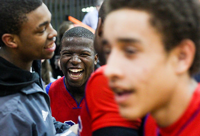 Sarah Nader- snader@shawmedia.com Dundee-Crown's Caleb Parson (center) celebrates with his teammates after the team beat Cary-Grove during the Class 4A Crystal Lake Central Regional Tuesday, March 4, 2014. Dundee-Crown won, 47-41.