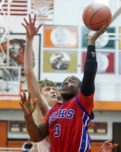 Sarah Nader- snader@shawmedia.com Cary-Grove's Michael Coleman (left) guards Dundee-Crown's Cordero Parson while he shoots during the second quarter of Tuesday's Class 4A Crystal Lake Central Regional March 4, 2014. Dundee-Crown defeated Cary-Grove, 47-41.
