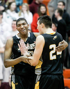 Sarah Nader- snader@shawmedia.com Jacobs' Robert Grant (left) and Cameron Krutwig celebrate after winning Tuesday's Class 4A Crystal Lake Central Regional game against Prairie Ridge on March 4, 2014. Jacobs' defeated Prairie Ridge, 55-46.