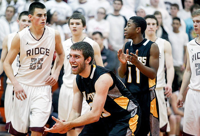 Sarah Nader- snader@shawmedia.com Jacobs' Ben Murray (center) celebrates during the last seconds of Tuesday's Class 4A Crystal Lake Central Regional game against Prairie Ridge on March 4, 2014. Jacobs' defeated Prairie Ridge, 55-46.
