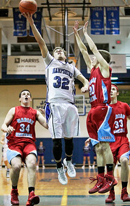 Michelle LaVigne/ For Shaw Media Hampshire's Ryan Cork shoots over Marian during the regional basketball game played in Woodstock on March 4, 2014. Marian Central won 62-61.