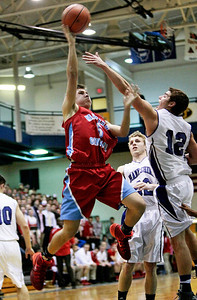 Michelle LaVigne/ For Shaw Media Marian's Adam Pischke goes to the basket against Hampshire in the 3A Woodstock regional basketball game March 4, 2014.  Marian Central won 62-61.