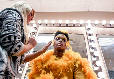 "Sarah Nader- snader@shawmedia.com Ashtyn Livorsi (left) of Fox Lake applies makeup and feathers to Warren Daniels, 16, before a dress rehearsal of  Marengo High School's spring musical, ""You're a Good Man Charlie Brown"" on Wednesday, March 5, 2014. The show opens on Thursday, March 6 at 7 p.m. and has showings on Friday at 7 p.m. and Saturday at 2 p.m. and 7.pm"