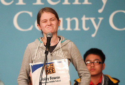 Sarah Nader- snader@shawmedia.com Haley Bowen reacts to her misspelled word while competing in the McHenry County Spelling Bee at McHenry County College in Crystal Lake Wednesday, March 5, 2014. Lucas Urbanski won the spelling bee for the fourth consecutive time. He will compete in the Scripps National Spelling Bee in Washington at the end of May.