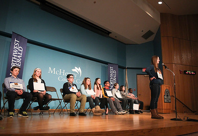 Sarah Nader- snader@shawmedia.com Laura Urbanski of Crystal Lake spells a word while competing in the McHenry County Spelling Bee at McHenry County College in Crystal Lake Wednesday, March 5, 2014. Lucas Urbanski beat out his sister, Clare, to win the spelling bee for the fourth consecutive time. He will compete in the Scripps National Spelling Bee in Washington at the end of May.