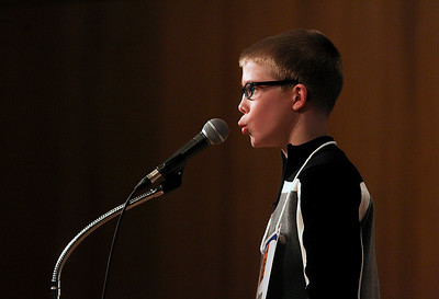 Sarah Nader- snader@shawmedia.com Chase Duncan spells a word while competing in the McHenry County Spelling Bee at McHenry County College in Crystal Lake Wednesday, March 5, 2014. Lucas Urbanski won the spelling bee for the fourth consecutive time. He will compete in the Scripps National Spelling Bee in Washington at the end of May.
