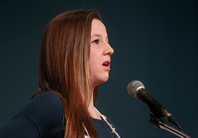 Sarah Nader- snader@shawmedia.com Laura Urbanski of Crystal Lake reacts to her misspelled word while competing in the McHenry County Spelling Bee at McHenry County College in Crystal Lake Wednesday, March 5, 2014. Lucas Urbanski beat out his sister, Clare, to win the spelling bee for the fourth consecutive time. He will compete in the Scripps National Spelling Bee in Washington at the end of May.