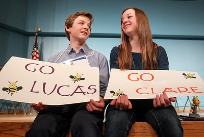 Sarah Nader- snader@shawmedia.com Lucas Urbanski (left) and his twin sister, Clare Urbanski, talk to each other after taking photos at the McHenry County Spelling Bee at McHenry County College in Crystal Lake Wednesday, March 5, 2014. Lucas Urbanski beat out his sister, Clare, to win the spelling bee for the fourth consecutive time. He will compete in the Scripps National Spelling Bee in Washington at the end of May.
