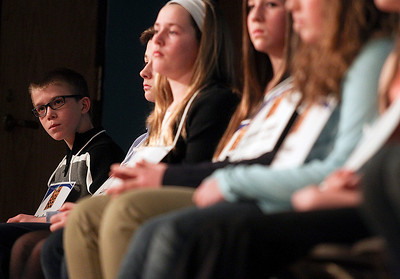 Sarah Nader- snader@shawmedia.com Chase Duncan (left) waits for his turn while competing in the McHenry County Spelling Bee at McHenry County College in Crystal Lake Wednesday, March 5, 2014. Lucas Urbanski won the spelling bee for the fourth consecutive time. He will compete in the Scripps National Spelling Bee in Washington at the end of May.