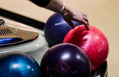 Kyle Grillot - kgrillot@shawmedia.com   A participant picks up a bowling ball Thursday night at Crystal Bowl during the Ladies Night of the Bowl for Kids' Sake fundraiser. This is the Big Brothers Big Sisters of McHenry County annual fundraiser to help children who face adversity. There are six more dates to bowl and raise money during the month of March. More information can be found at www.bbbsmchenry.org/bowl.