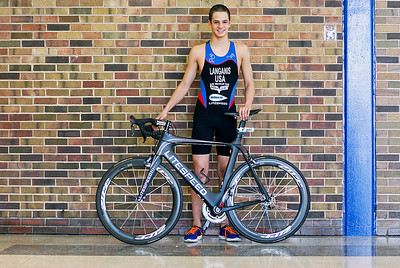 Sarah Nader- snader@shawmedia.com All-American triathlete Cooper Langanis, 15, of Cary poses for a portrait with his bike inside Cary-Grove High School  Wednesday, March 5, 2014.