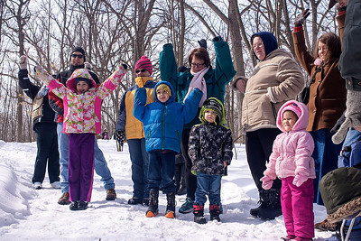 Kyle Grillot - kgrillot@shawmedia.com   A group of participants demonstrate the different shapes of trees during the annual Festival of the Sugar Maples at Coral Woods Conservation Area Saturday in Marengo.