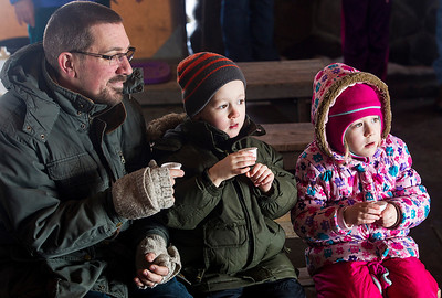 Kyle Grillot - kgrillot@shawmedia.com   Brian Weidner and his twins Noah and Natalie, both 5, wait to sample maple syrup during the annual Festival of the Sugar Maples at Coral Woods Conservation Area Saturday in Marengo.