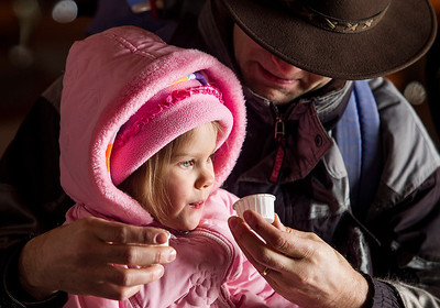 Kyle Grillot - kgrillot@shawmedia.com   Chuck Ruehl of Ingleside gives his daughter Lydia, 3, a sip of maple syrup during the annual Festival of the Sugar Maples at Coral Woods Conservation Area Saturday in Marengo.