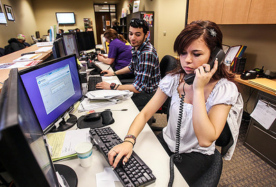 Sarah Nader- snader@shawmedia.com Student employees Justin Rodriguez (left), 24, of Richmond and Natalie Diversiev, 20, of Crystal Lake work at the advising office at  McHenry County College in Crystal Lake Thursday, March 6, 2014.