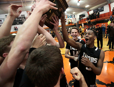 Kyle Grillot - kgrillot@shawmedia.com   Jacobs junior Chris Orange (right) celebrates with his teammates after beating Dundee-Crown in the Class 4A Crystal Lake Central Regional final Friday, March 7, 2014. Jacobs beat Dundee-Crown, 43-33.