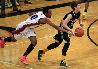 Kyle Grillot - kgrillot@shawmedia.com   Dundee-Crown junior Kiwaun Seals tips the ball from Jacobs junior Corey Boeckh during the third quarter of the Class 4A Crystal Lake Central Regional final Friday, March 7, 2014. Jacobs beat Dundee-Crown, 43-33.