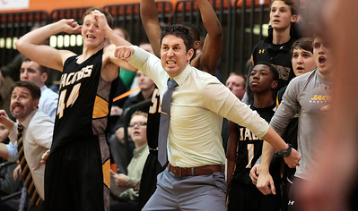 Kyle Grillot - kgrillot@shawmedia.com   Jacobs head coach Jimmy Roberts cheers after a shot is made during the fourth quarter of the Class 4A Crystal Lake Central Regional final Friday, March 7, 2014. Jacobs beat Dundee-Crown, 43-33.