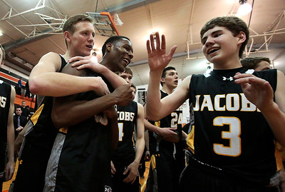 Kyle Grillot - kgrillot@shawmedia.com   Jacobs senior Reilly Peltier (left), Chris Orange (center), and Corey Boeckh celebrate after beating Dundee-Crown in the Class 4A Crystal Lake Central Regional final Friday, March 7, 2014. Jacobs beat Dundee-Crown, 43-33.
