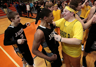 Kyle Grillot - kgrillot@shawmedia.com   Jacobs junior Kenton Mack (center) and junior Kyle Wolinksi celebrate with fans after beating Dundee-Crown in the Class 4A Crystal Lake Central Regional final Friday, March 7, 2014. Jacobs beat Dundee-Crown, 43-33.