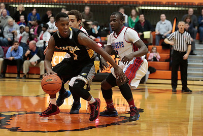 Kyle Grillot - kgrillot@shawmedia.com   Jacobs junior Chris Orange (left) dribbles around Dundee-Crown senior Zach Pochop and junior Malik Dunner (right) during the fourth quarter of the Class 4A Crystal Lake Central Regional final Friday, March 7, 2014. Jacobs beat Dundee-Crown, 43-33.