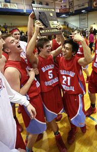 John Konstantaras - For Shaw Media (L-R) Marian Central's Jack Quinlan (32), Adam Pischke (5) and Marian Central's Derreck Caldez (21) raise the regional championship plaque after beating Marengo at Woodstock High School Friday March 7, 2014 Woodstock.  The Hurricanes won the game 72-53.