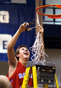 John Konstantaras - For Shaw Media Marian Central's Adam Pischke (5) cuts down one of the nets after winning their Class 3A regional final game against Marengo at Woodstock High School Friday March 7, 2014 Woodstock. Pischke  had 6 3-point baskets as the Hurricanes won the game 72-53.