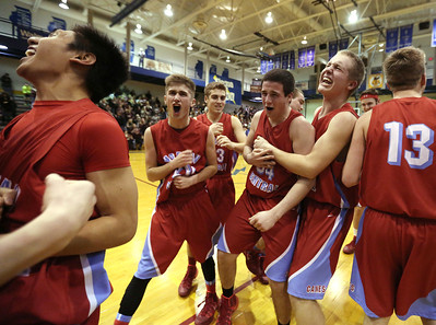 John Konstantaras - For Shaw Media Marian Central players celebrate after winning their Class 3A regional final game against Marengo at Woodstock High School Friday March 7, 2014 Woodstock.  The Hurricanes won the game 72-53.