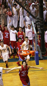 John Konstantaras - For Shaw Media Marian Central's Derreck Caldez (21) sinks a 3-point basket to end the third quarter of their Class 3A regional final game against Marengo at Woodstock High School Friday March 7, 2014 Woodstock.  The Hurricanes won the game 72-53.