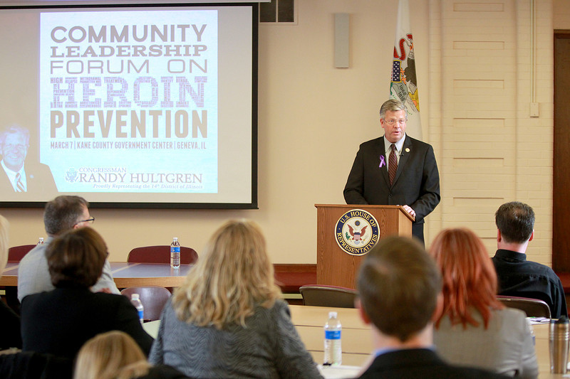 U.S. Rep. Randy Hultgren (R-Winfield) addresses Kane County and other Illinois officials during a Community Leadership Forum on Heroin Prevention Friday at the Kane County Government Center in Geneva.