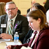 Kane County Coroner Rob Russell (left) attends a Community Leadership Forum on Heroin Prevention Friday at the Kane County Government Center in Geneva.