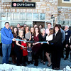 Brynn Hanson (center), owner of Pure Barre exercise studio, cuts the ribbon to her business Thursday. Pure Barre is located at 500 S. 3rd St. in Geneva.