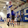 Geneva's Janie McCloughan (right) blocks a shot from teammate Amelia Grady during practice at the school Wednesday. The Geneva girls team plays Rolling Meadows in the 4A state semifinal today in Normal.