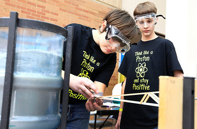 Candace H. Johnson Michael Drozt, 12, of Prairie Grove and Jacob Lawrence, 13, of Cary demonstrate their Boomilever experiment during the College of Lake County's Regional Science Olympiad Competition in Grayslake. Both are students at the Hannah Beardsley Middle School in Crystal Lake.