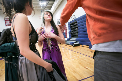 "Michelle LaVigne/ For Shaw Media While shopping for a prom dress at the Big Brother's Big Sister's ""My Sister's Dress"" event at McHenry County College in Crystal Lake on Sunday, March 5th, 2014, Shelby Weidner, 18, center, of Crystal Lake gets second opinion on one of her dress choices from her brother, Corey McCullary and friend Kieran Ruddy, 18, also of Crystal Lake. A photo was later sent to her boyfriend to weigh in on the final decision."