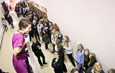 "Michelle LaVigne/ For Shaw Media ""MoJo,"" the nighttime radio DJ with Star 105.5, makes an announcement that the doors will soon be opening to participants lined up to enter the Big Brother's Big Sister's ""My Sister's Dress"" prom dress sales event at McHenry County College in Crystal Lake on Sunday, March 5th, 2014. New and used prom dresses were donated by local residents, as well as Shelley's  Bridal Couture, Gippers Formal Wear, Kathryn's Bridal and Volle's Bridal & Boutique."