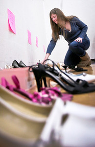 "Michelle LaVigne/ For Shaw Media Kelly Donovan, 18, of Lake in the Hills, checks out the shoe selection at the Big Brother's Big Sister's ""My Sister's Dress"" prom dress event at McHenry County College in Crystal Lake on Sunday, March 5th, 2014."