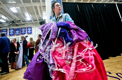 "Michelle LaVigne/ For Shaw Media With her armful of possible prom dresses, Antionette Menge, 18, of Hebron, looks for her mother before heading to the fitting rooms at the Big Brother's Big Sister's ""My Sister's Dress"" prom dress sales event at McHenry County College in Crystal Lake on Sunday, March 5th, 2014. Dresses, shoes and accessories were included in the donated items for sale."