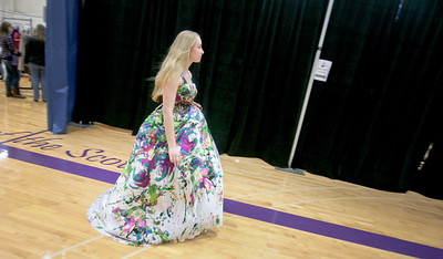 "Michelle LaVigne/ For Shaw Media Tally Lalor, 15, of Hebron heads back to the dressing room while shopping at the Big Brother's Big Sister's ""My Sister's Dress"" event at McHenry County College in Crystal Lake on Sunday, March 5th, 2014. Lalor later purchased the dress for her prom."