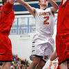 St. Charles East's Dom Adduci goes up for a shot during their IHSA St. Charles North Regional game against South Elgin Friday night.
