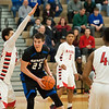 Matt Grotto - For Shaw Media<br /> <br /> Geneva's Nate Navigato (25) looks for room while being defended by Bolingbrook's Gage Davis (far left) during the third quarter at Plainfield East High School Friday, March 7, 2014, in Plainfield, Ill.