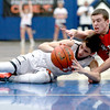 St. Charles East's Jake Clodi (left) and South Elgin's Matt McClure battle for the ball during their IHSA St. Charles North Regional game Friday night.