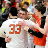 St. Charles East's Dom Adduci hugs teammate Jake Asquini (33) in the final seconds of their St. Charles North regional game loss to South Elgin Friday night.