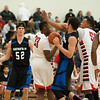 Matt Grotto - For Shaw Media<br /> <br /> Geneva's Mike Landi (left) and Chris Parrilli (at right) converge on Bolingbrook's Joshua Dillingham (center) during the first quarter at Plainfield East High School Friday, March 7, 2014, in Plainfield, Ill.