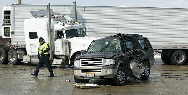 H. Rick Bamman - hbamman@shawmedia.com  Police investigate the scene following an accident between a semi-truck and a Ford SUV at Kreutzer Road and Route 47 in Huntley on Wednesdaym March 12, 2014. Flight for Life transported a woman to Advocate Condell Medical Center in Libertyville.