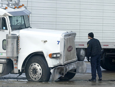 A Police investigator check the cab of a semi-truck at Kreutzer Road and Route 47 in Huntley. H. Rick Bamman - hbamman@shawmedia.com